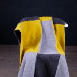 Grå/gult putepledd utslått