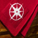Kompass pledd rød